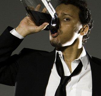 Aasif mandvi drinking.jpg